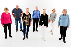 A group of seven men and women who belong to the Fremantle Hospital Consumer Advisory Council stand together.