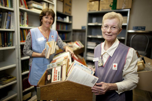Red Cross volunteers in library