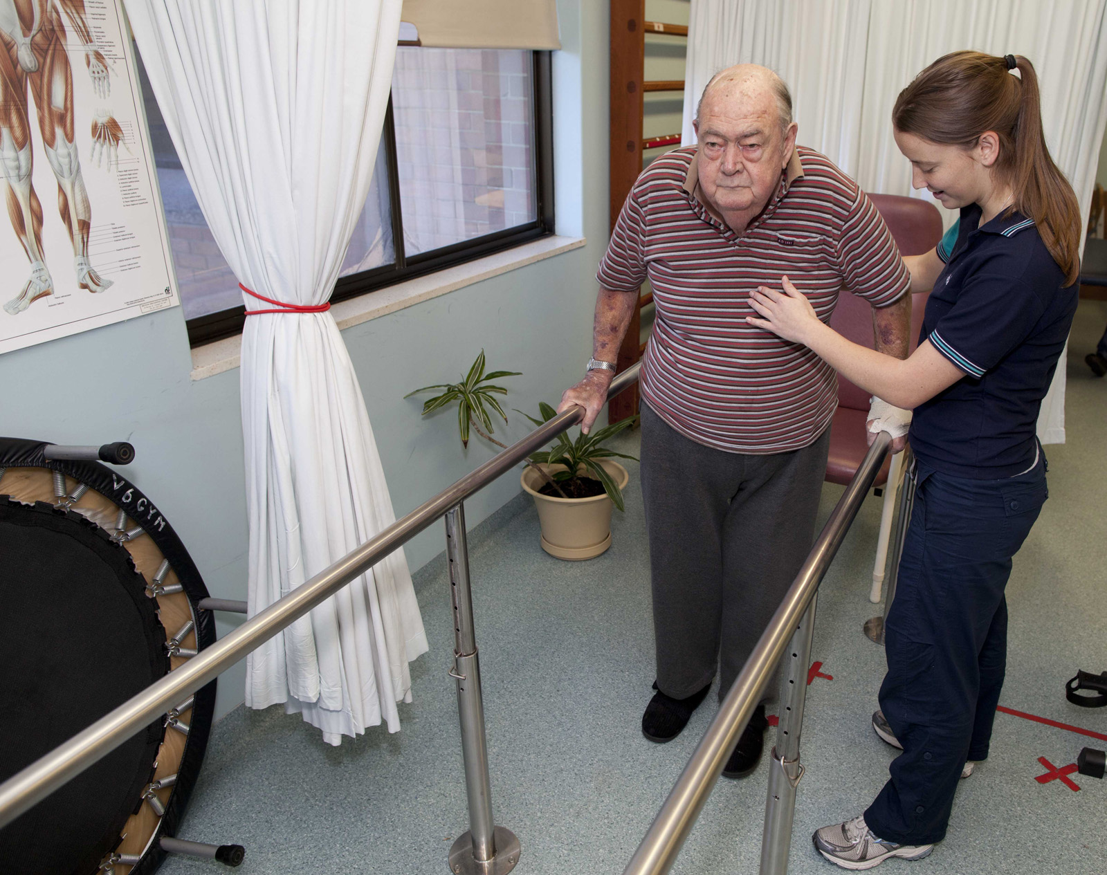 Patient practising walking with the help of a physiotherapist