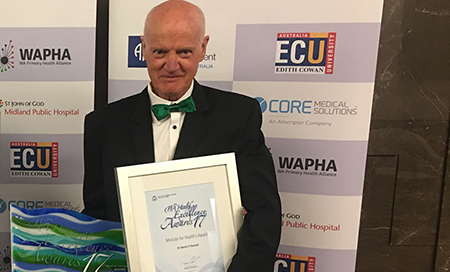 Retired Fremantle Hospital Medical Consultant Dr Dan O'Donnell holding an award certificate