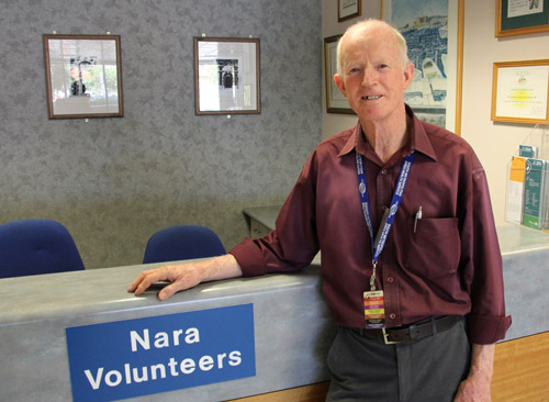 Nara volunteer at the Nara desk